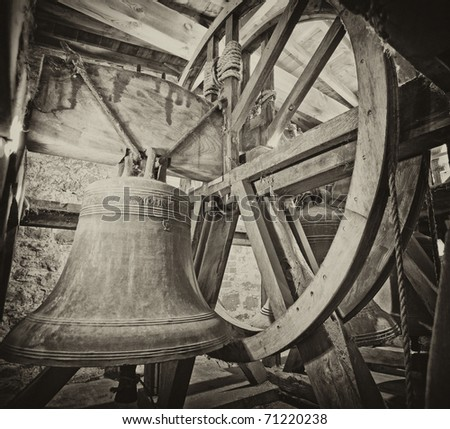 Traditional old bells in a church tower from the middle ages in black and white
