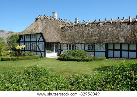 Traditional old classic decorative style Danish country thached roof  house home Denmark