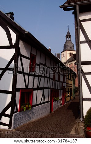 Traditional old house and church in town Heimbach, Germany