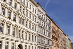Traditional old residential buildings in the district of Kreuzberg, in the German capital. Horizontal detail view of several traditional, classic buildings in a row, in Berlin