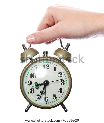 Traditional old-style alarm clock in woman's hand. isolated on white