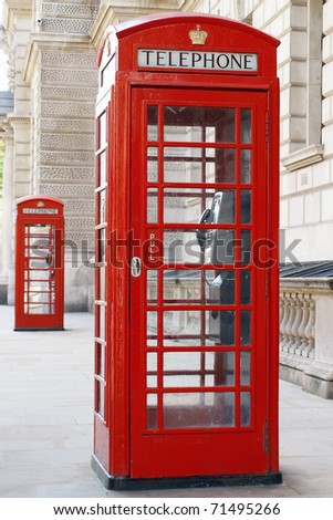 Traditional Old Style British Red Phone Boxes on a London Street