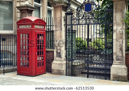 Traditional old style UK red phone box in London.