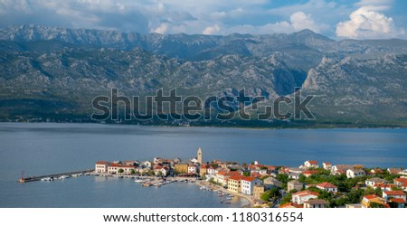 Traditional old village Vinjerac, Croatia, Velebit mountains and Paklenica national park in background, dramatic sky clouds, high angle from above