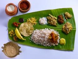 Traditional Onam Sadya served on a banana leaf on Festival day in Kerala