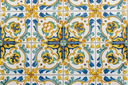 Traditional ornate italian decorative ceramic tiles from Vietri, colorful background