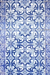 Traditional ornate portuguese decorative tiles azulejos in white and blue colours.