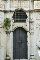 Traditional Ottoman entrance door of Ilim Yayma Vakfi Recai Efendi Kutuphanesi. It is old Ottoman time building. Located in Vefa, Istanbul, Turkey