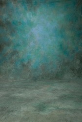 Traditional painted canvas or muslin fabric cloth studio backdrop or background, suitable for use with portraits, products and concepts. Shades of blue and green