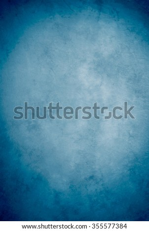 Traditional painted canvas or muslin fabric cloth studio backdrop or background, suitable for use with portraits, products and concepts. Shade of blue, lighter in the center, darker on edges. #355577384