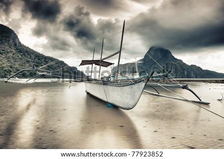 Traditional philippine boat bangka at sunset time
