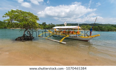 Traditional philippine boat on the mangrove river at Busuanga island, Palawan, Philippines.  Travel concept