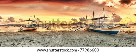 Traditional philippine boats bangka at sunset time