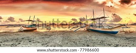 Traditional philippine boats bangka at sunset time