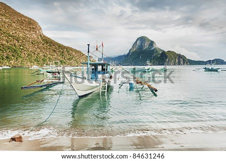 Traditional Philippine boats Bangkok in lagoon of El Nido