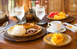 Traditional Philippino breakfast with garlic rice and adobo