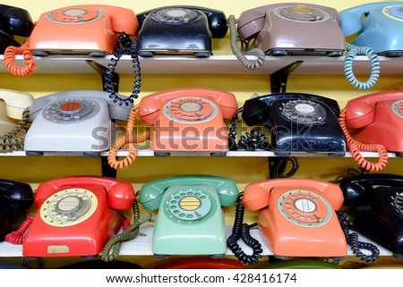 Traditional Phone many colors on wooden shelves.