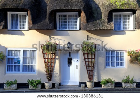 Traditional picturesque thatched buildings in the rural village of lulworth - stock photo