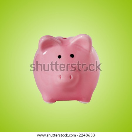 Traditional piggybank isolated on green with clipping path