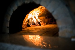 Traditional Pizza oven, burning wood and flames in fireplace