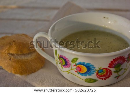 traditional polish potato soup in consomme dishes with folk ornaments #582623725