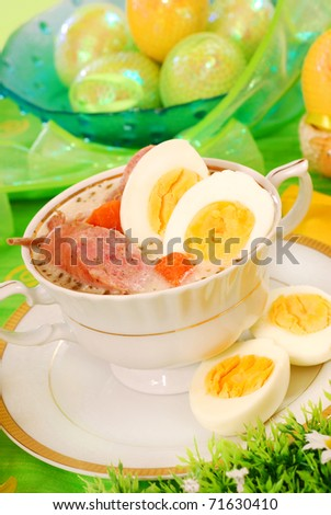 traditional polish white borscht with eggs and sausage in white dishware   for easter