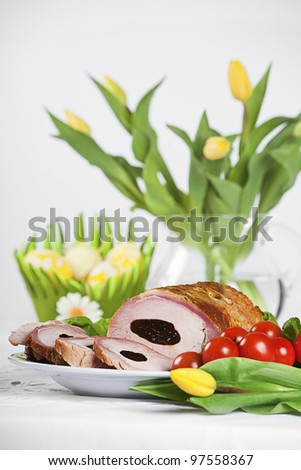 traditional pork loin dish with easter decorations - stock photo