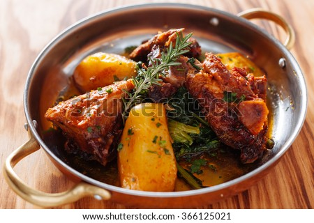 traditional Portuguese dish roasted lamb and potatoes #366125021
