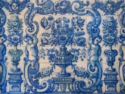 Traditional Portuguese, glazed ceramic tiles. Azulejo white, blue ornate pattern, for design, backdrop. Abstract background from old decorative painted tiles, religious theme with angels and flowers.