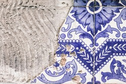 Traditional Portuguese title - azulejo, local pattern on the walls of Portuguese houses, a broken edge of a title