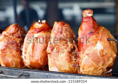 Traditional Prague dish - roasted pork leg on a grill