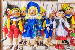 Traditional puppets made of wood. Shop in Prague