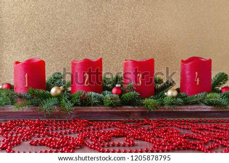 traditional red advent candles with numbers and christmas decoration, branch of fir with garland on gold background #1205878795