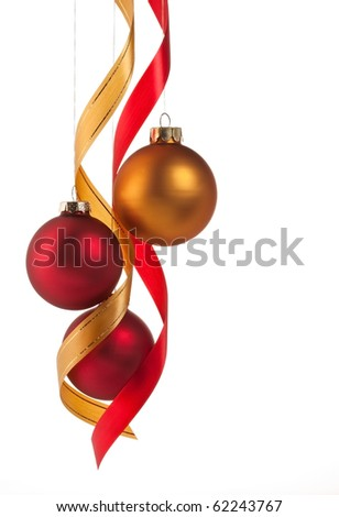 Traditional red and gold Christmas ball ornaments with ribbons on white