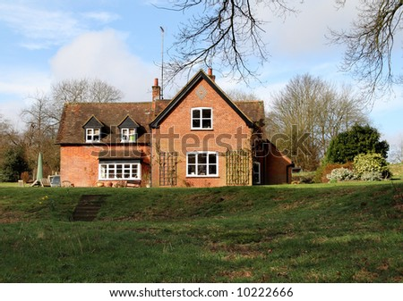 Traditional Red Brick English Rural House and garden