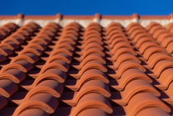 Traditional red clay roof tiles in Krk Croatia, harbour town and touristical destination on an adriatic island on a sunny summer day