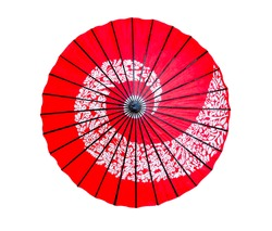 Traditional red Japanese paper umbrella isolated on white background