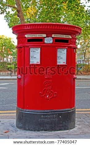 Traditional red mail-box in London, UK