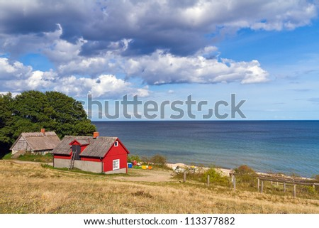 Traditional red Swedish cottage house at Baltic Sea