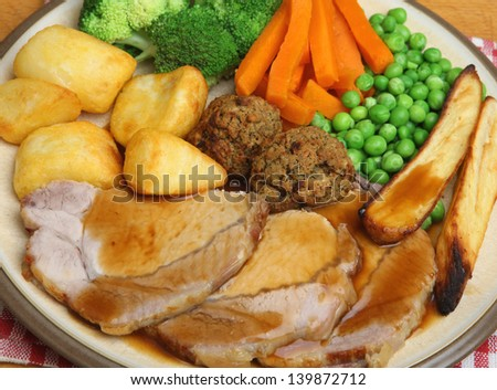 Traditional roast pork Sunday dinner. - stock photo