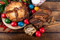Traditional Romanian Easter table with cozonac and pasca meaning Sweetbread and Matzo an unleavened flatbread that is part of Jewish cuisine and forms an integral element of the Passover. Happy Easter