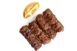 Traditional Romanian grilled dish ,mici or mititei on white with mustard