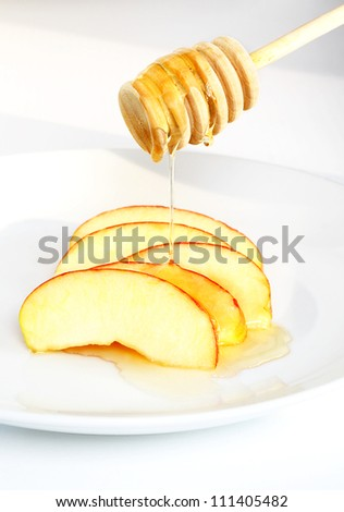Traditional Rosh Hashanah sweet food of apple slices and honey