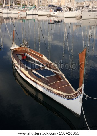 traditional row boat moored in Senglea Marina, Malta