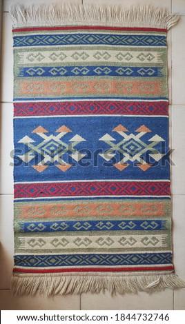 Traditional rug isolated on floor Stok fotoğraf ©