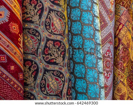 Traditional rugs in Turkey - oriental crafts and ethnic decor of interior. Handmade woven rugs and tapestry - colorful carpets on a Turkish Bazaar. Arabic tapestries as ornamental background.