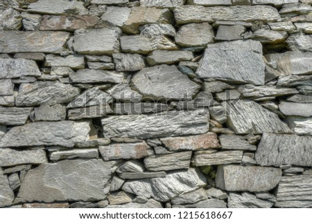 Traditional, rural, dry stone wall around a field in countryside near Rhoscolyn, Anglesey, Wales #1215618667