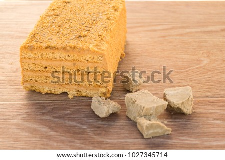 Traditional Russian baked honey cake on wooden table #1027345714