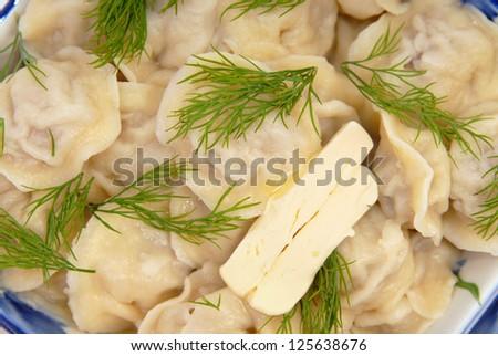 Traditional russian dish - pelmeni (dumplings) with spice