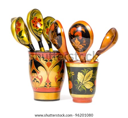 Traditional Russian floral decorated khokhloma wooden spoons isolated on white background